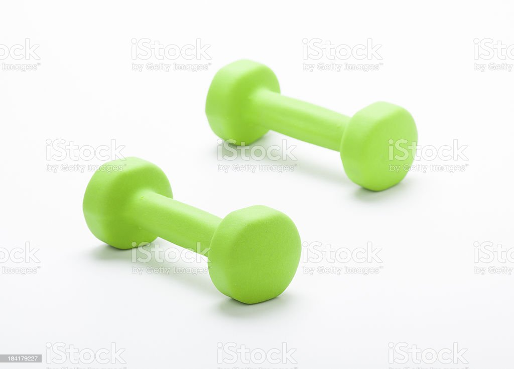 small green dumbbells,  isolated in white background royalty-free stock photo