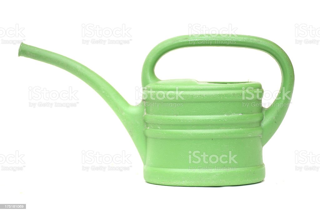 small green watering can - grüne Gießkanne stock photo
