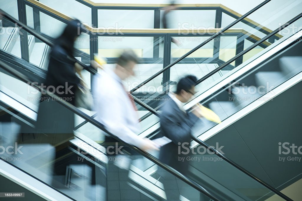 Small Group of Businesspeople on Escalator royalty-free stock photo