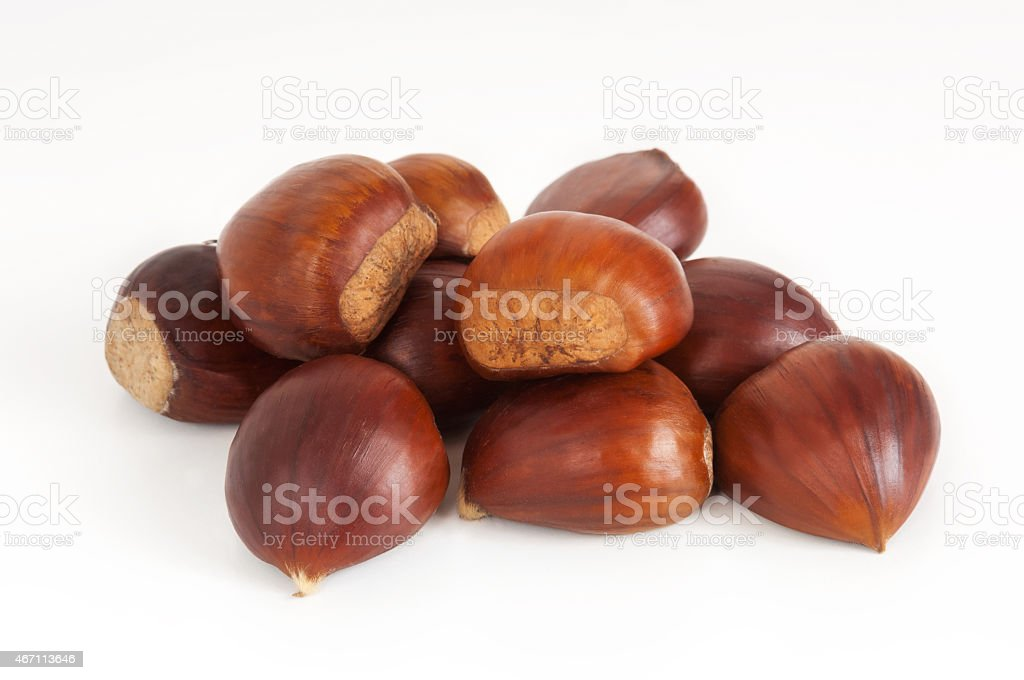 Small group of chestnuts on white stock photo