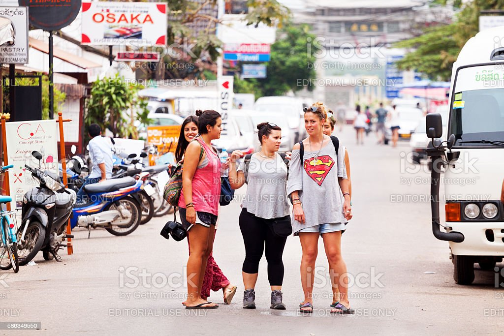 Small group of female tourists in Vientiane stock photo
