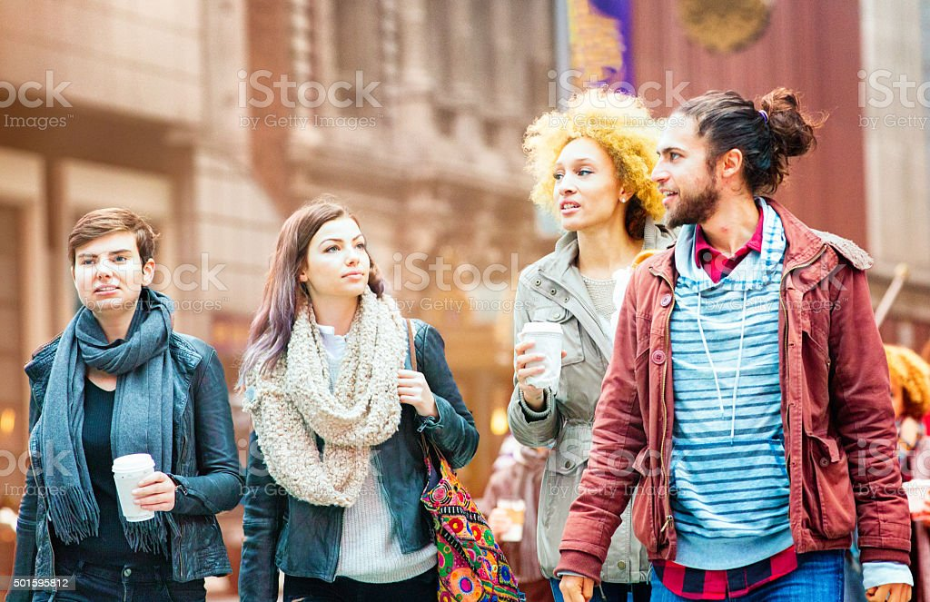 Small group of friends visiting Broadway stock photo