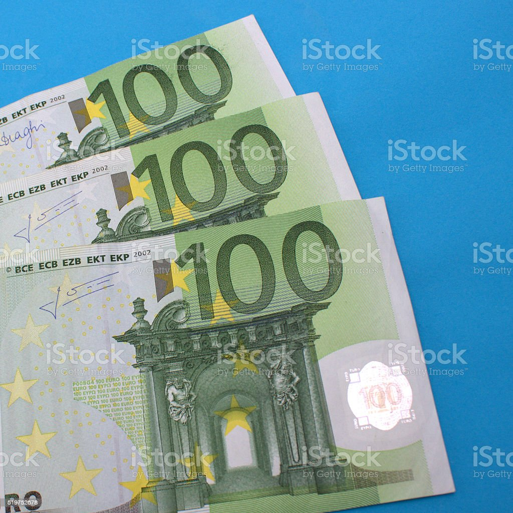 Small group of one hundred banknotes over blue bakcground stock photo