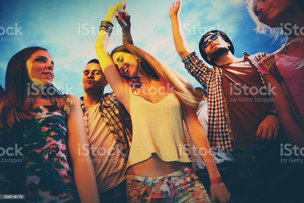 Small group of people having fun at concert. stock photo