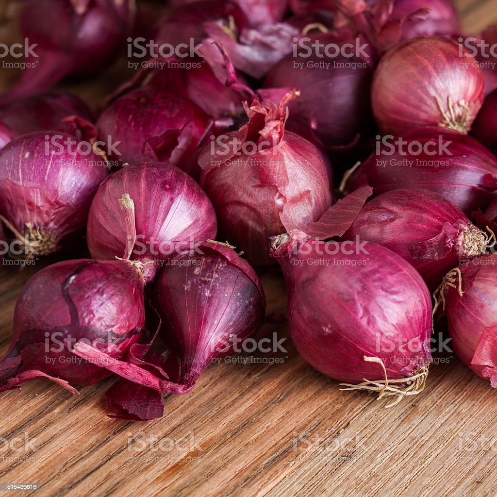 Small group of red pearl onions stock photo