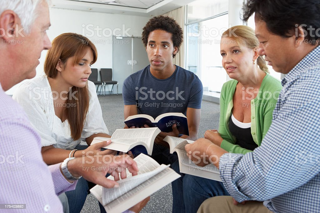 Small group studying the Bible stock photo