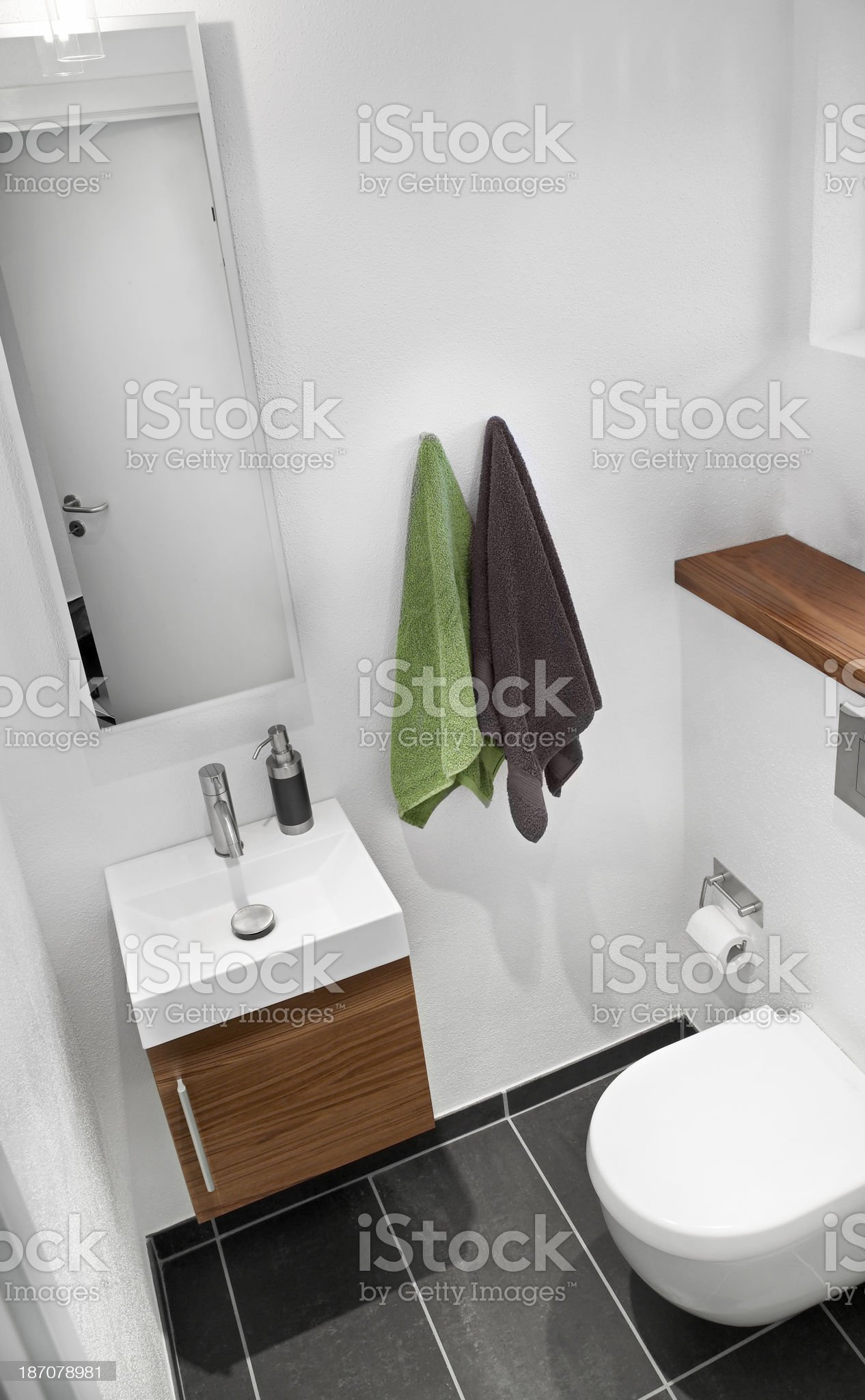 Small guest toilet with sink and towels royalty-free stock photo