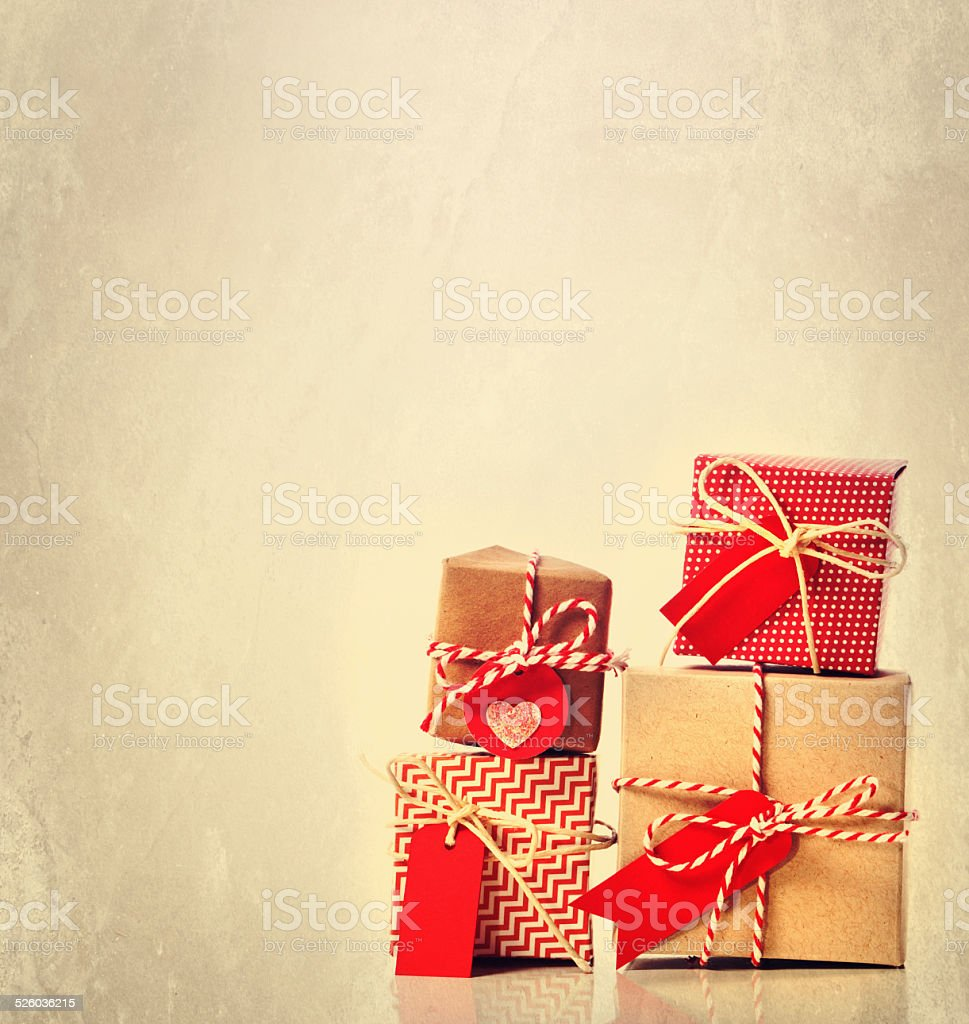 Small handmade gift boxes on pastel background stock photo