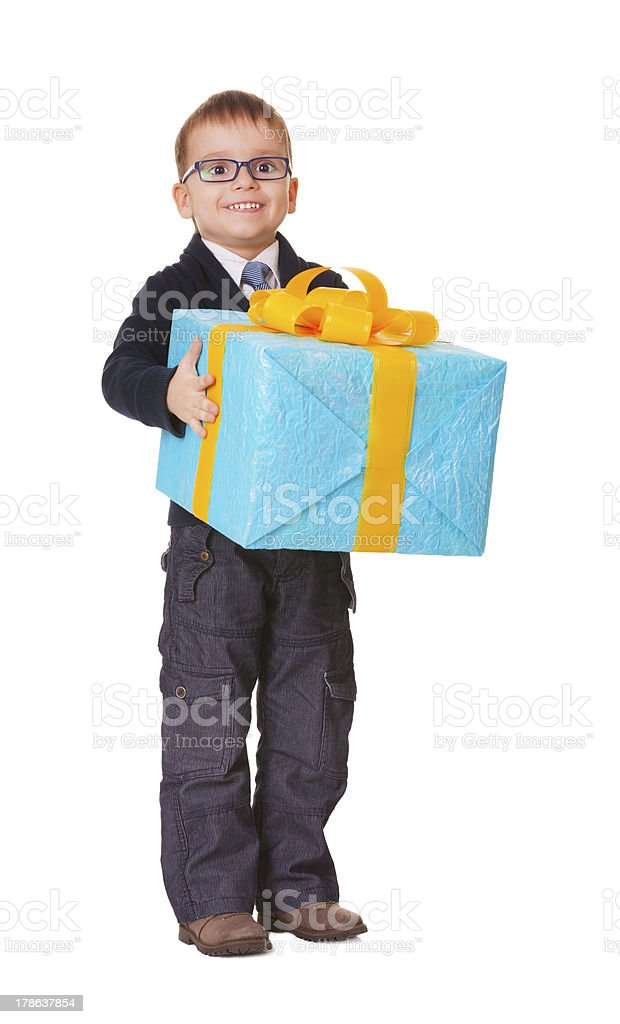 Small happy boy in spectecles with big present royalty-free stock photo