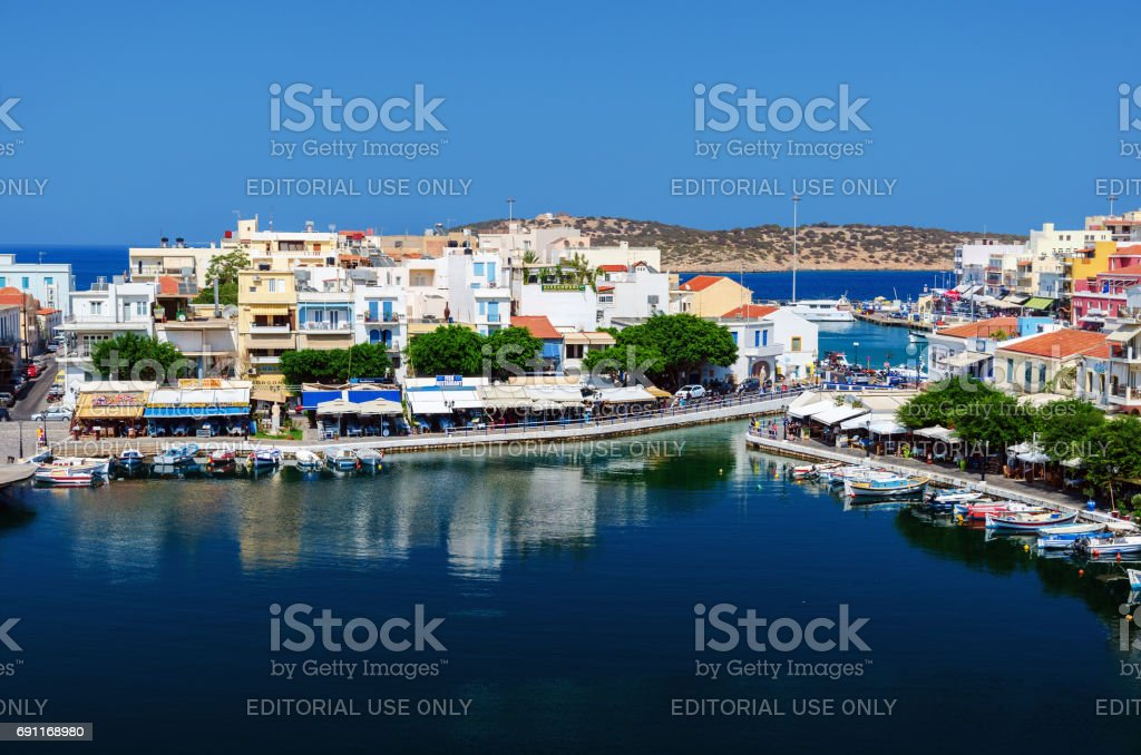 Small harbor with moored fishing boats at Aghios Nikolaos town on Crete island, Greece stock photo
