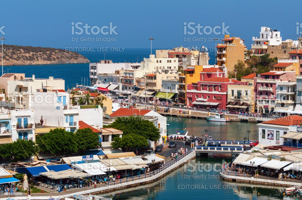 Small harbor with moored fishing boats at Aghios Nikolaos town on Crete island, Greec stock photo