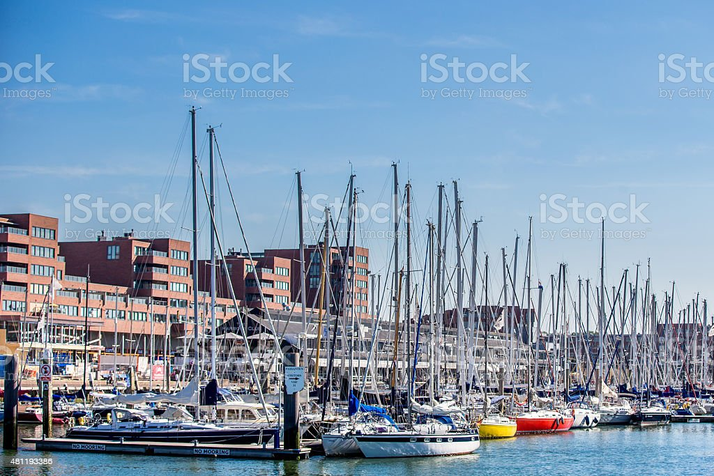 Small harbour with sailing boats on a blue sky stock photo