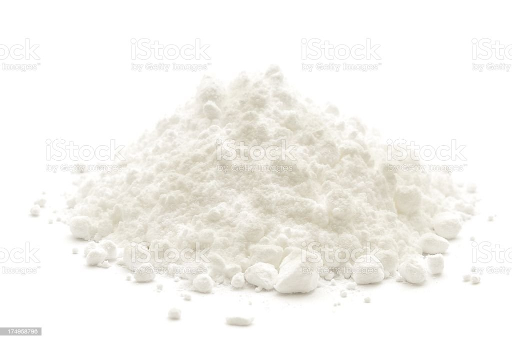 A small heap of icing sugar on a white background stock photo
