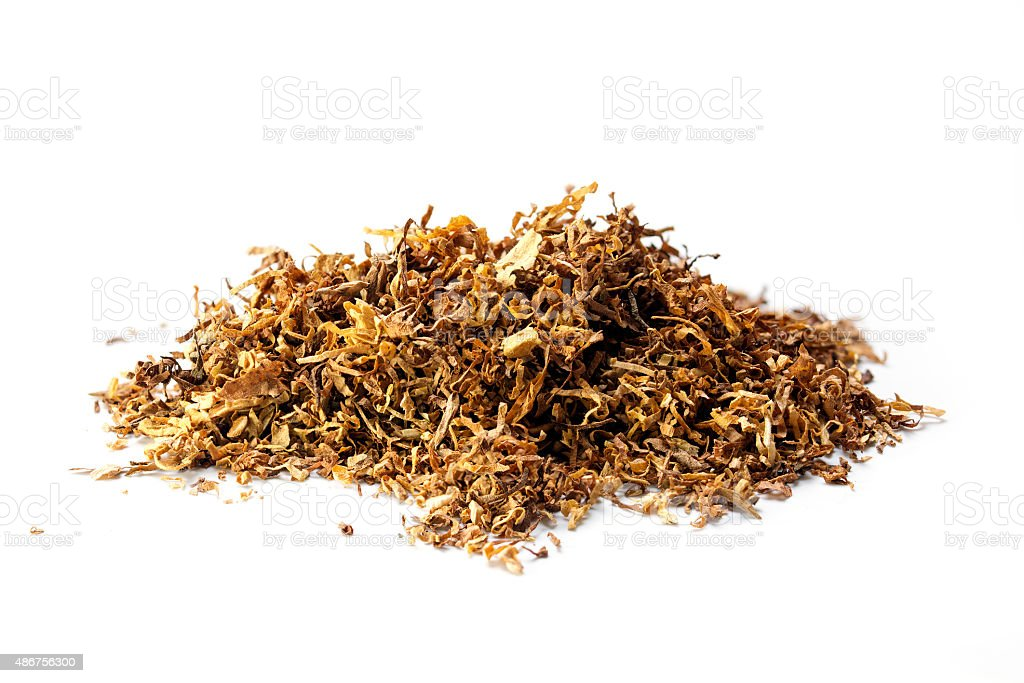 small heap of loose tobacco,  isolated on a white background stock photo