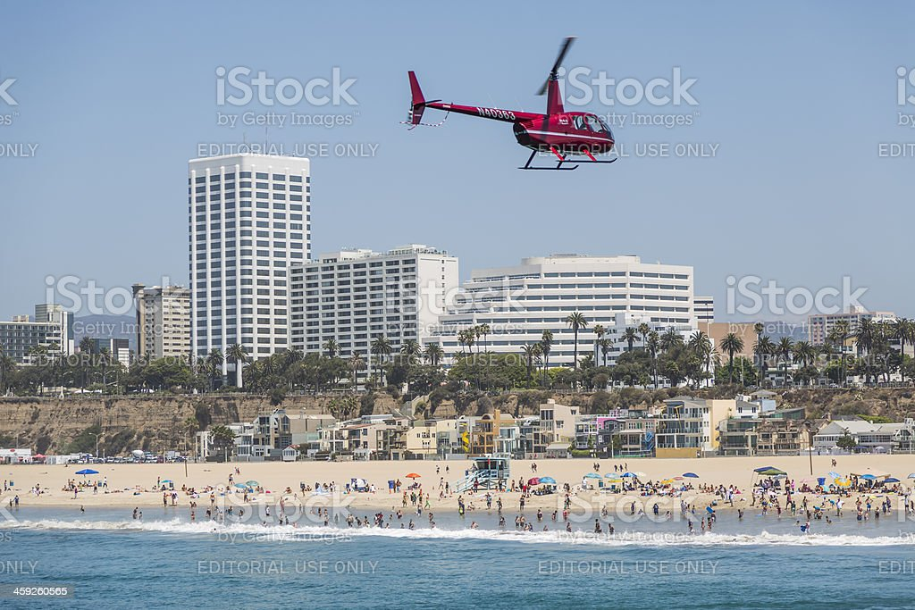 Small Helicopter hovers over Santa Monica Beach royalty-free stock photo