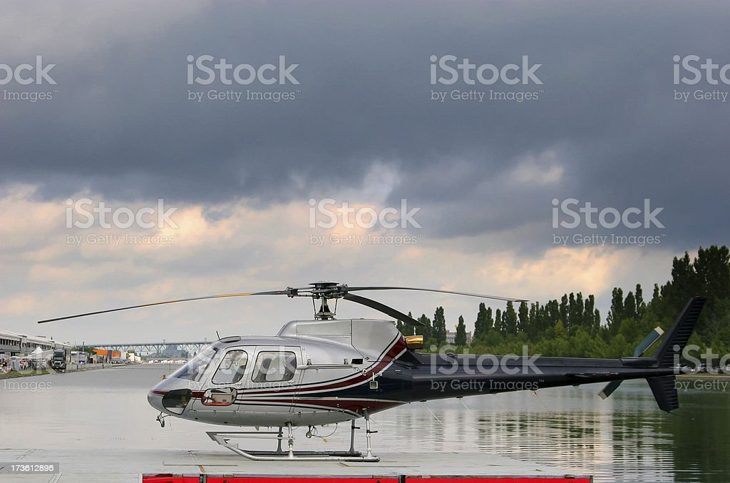 Small Helicopter on helipad stock photo