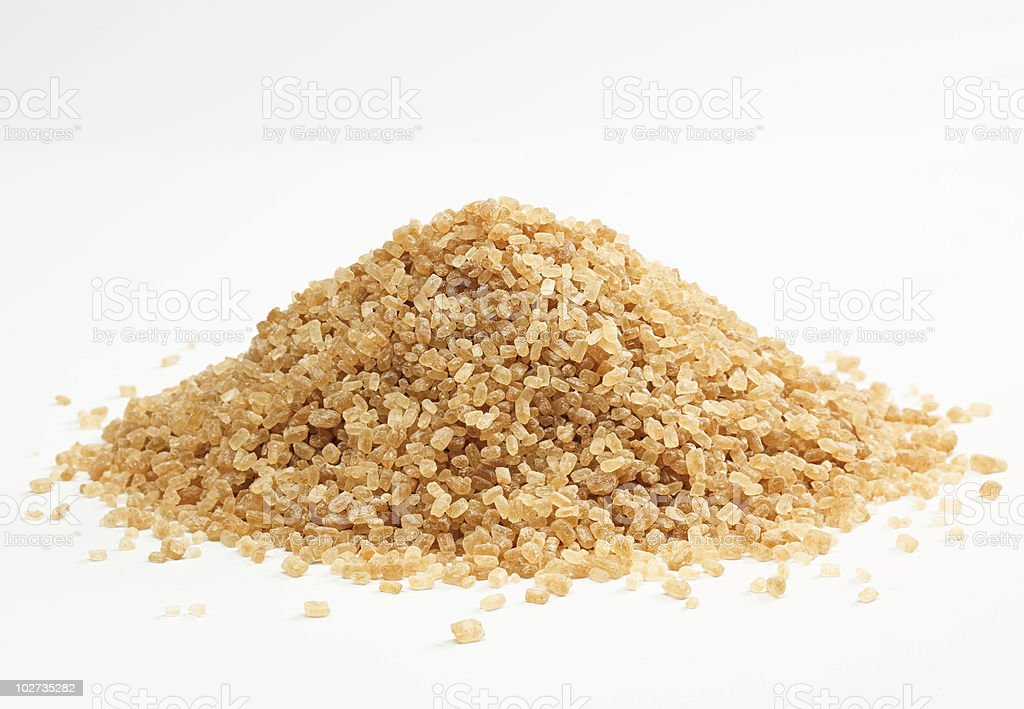 Small hill of cane sugar isolated on white surface royalty-free stock photo