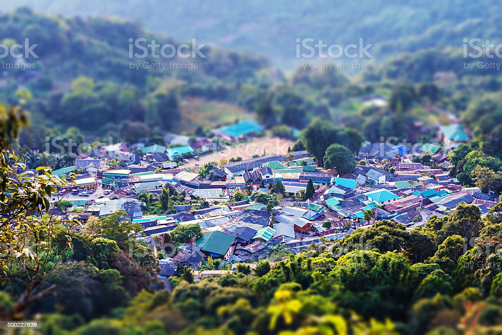Small hill tribe village in valley with tiltf-shift effect stock photo
