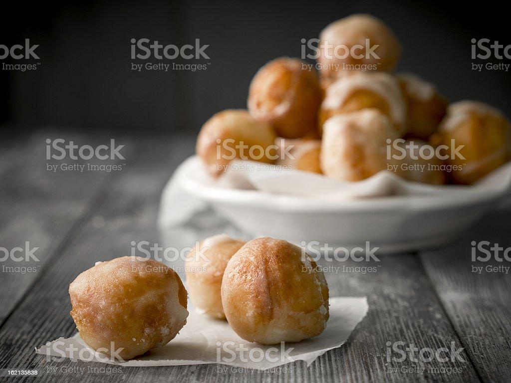 Small homemade doughnuts, also known as doughnut holes stock photo