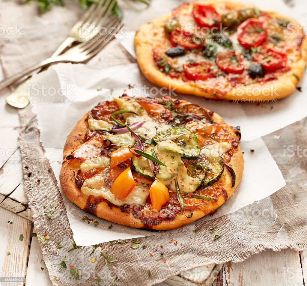 Small homemade pizzas with addition of vegetables stock photo