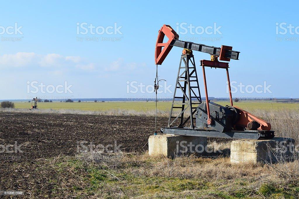 Small horsehead pump in the fields near Sabla, Bulgaria stock photo