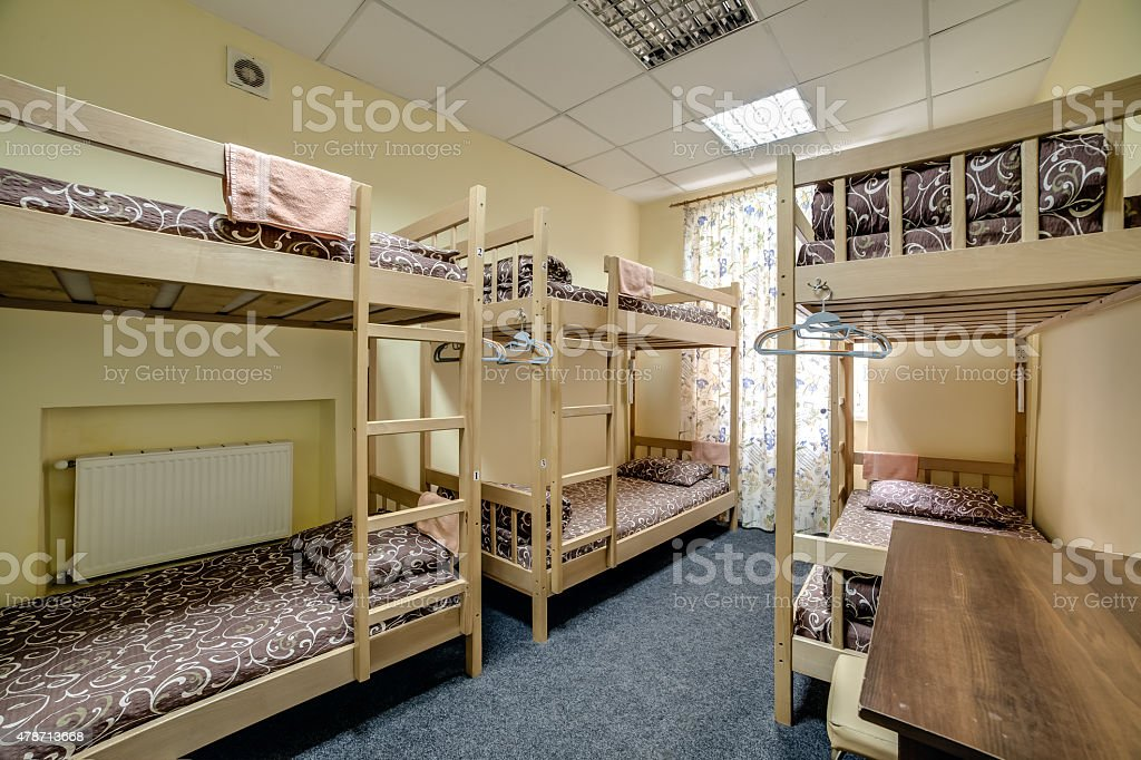 Small hostel room with bunk beds stock photo