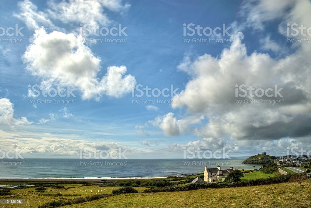 Small house by the sea on a beautiful day stock photo