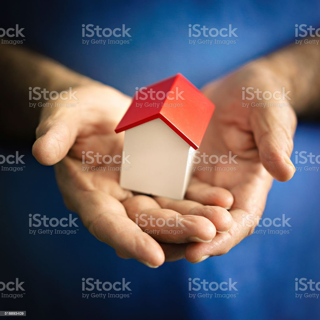 Small house hold by a senior man stock photo