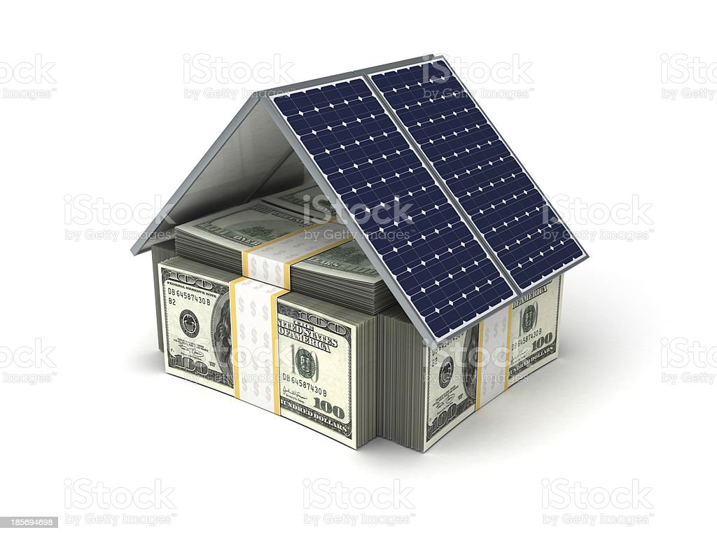 Small house made of banknotes and solar panels royalty-free stock photo