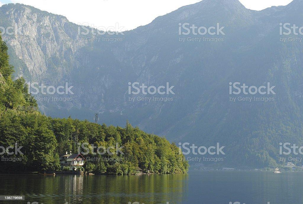 Small house on a beautiful lake stock photo