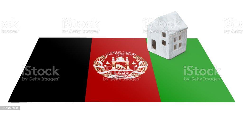Small house on a flag - Afghanistan stock photo