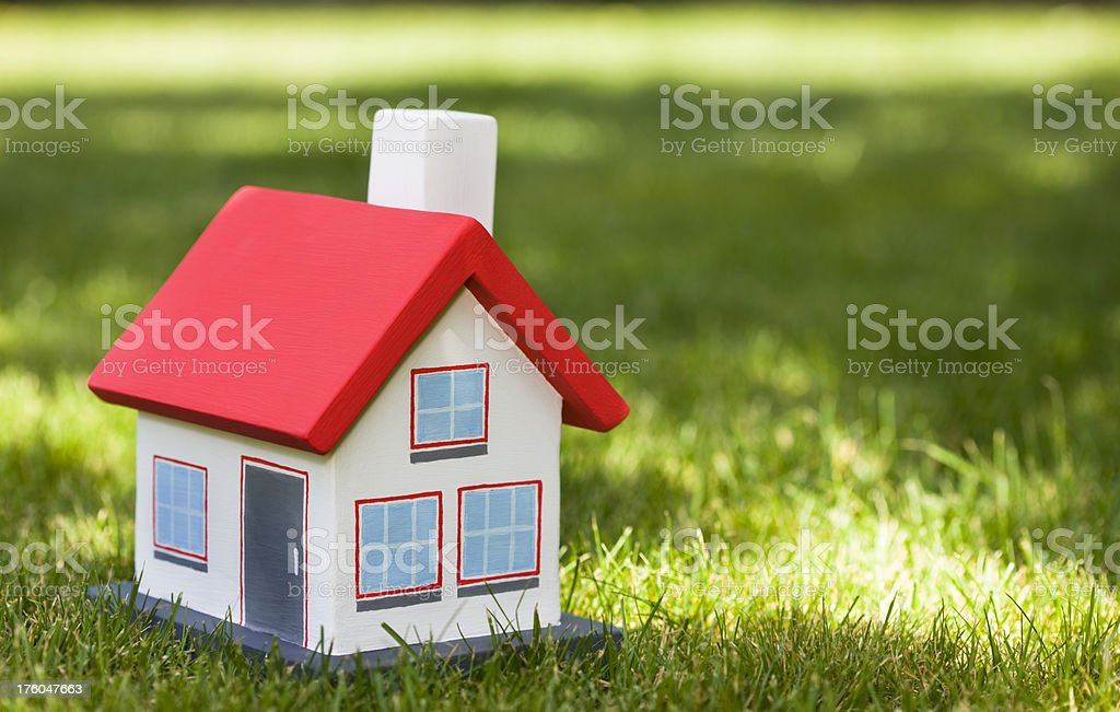 small house on a green grass royalty-free stock photo