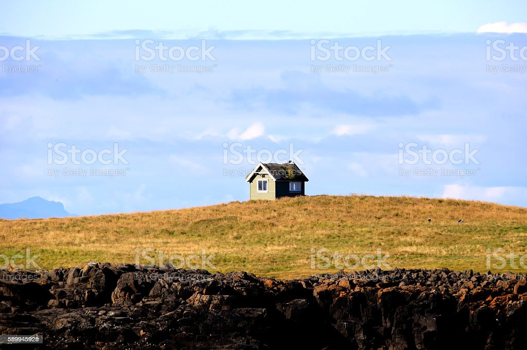 Small house on a small Island stock photo