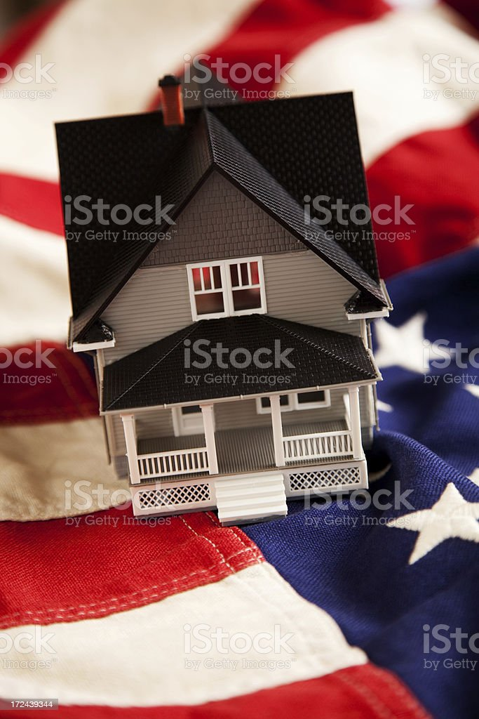 Small House on American Flag royalty-free stock photo