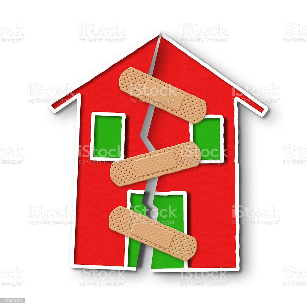 Small house with a deep crack in the wall stock photo