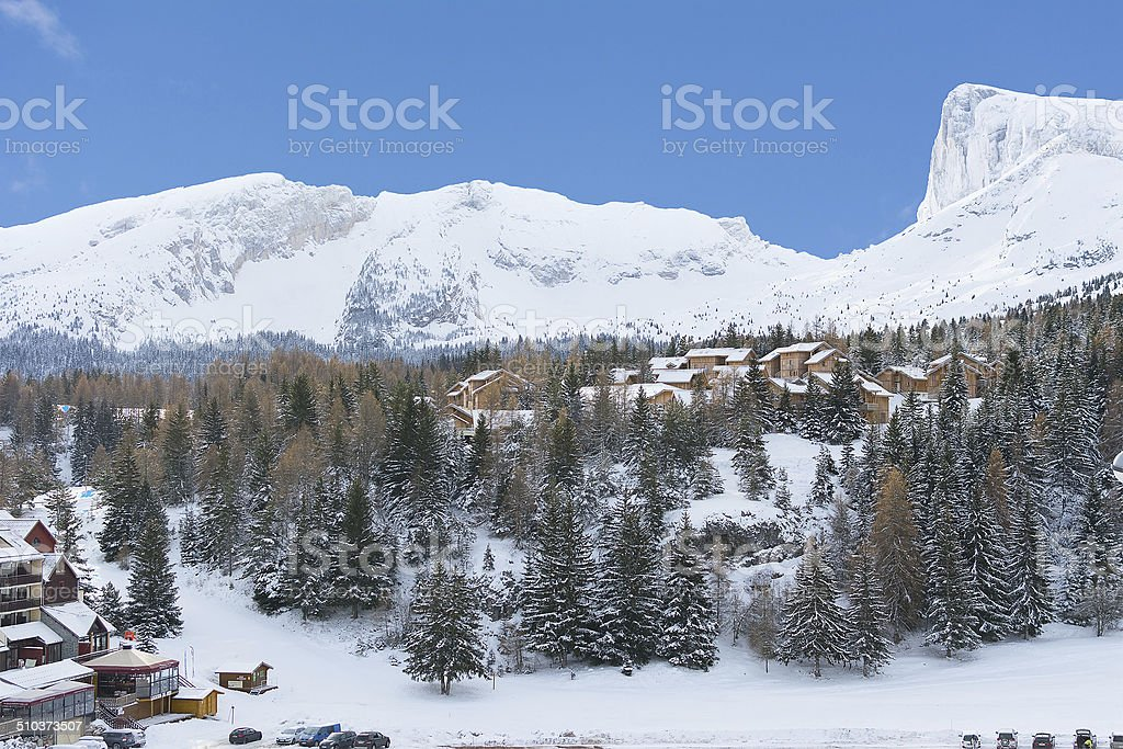 Small houses at the base of the mountains stock photo