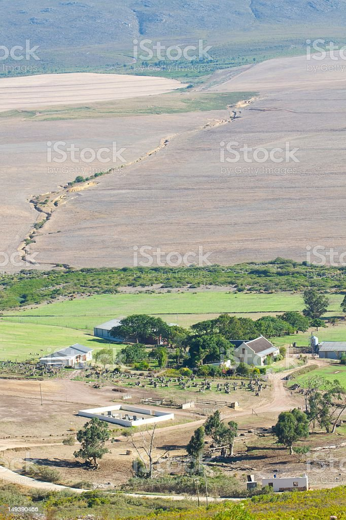 Small Houses, Cemetery, Fields at the foot of a Mountain stock photo