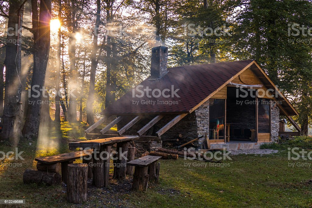Small hut among the woods in the mountain stock photo