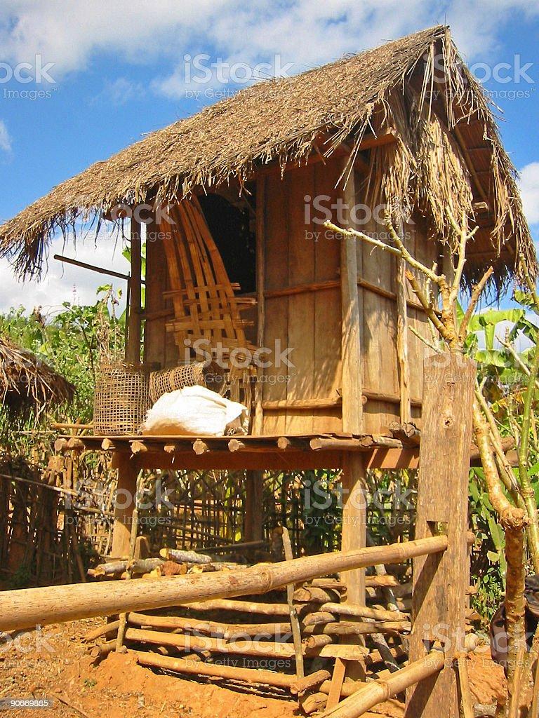 small hut  dusy village laos royalty-free stock photo