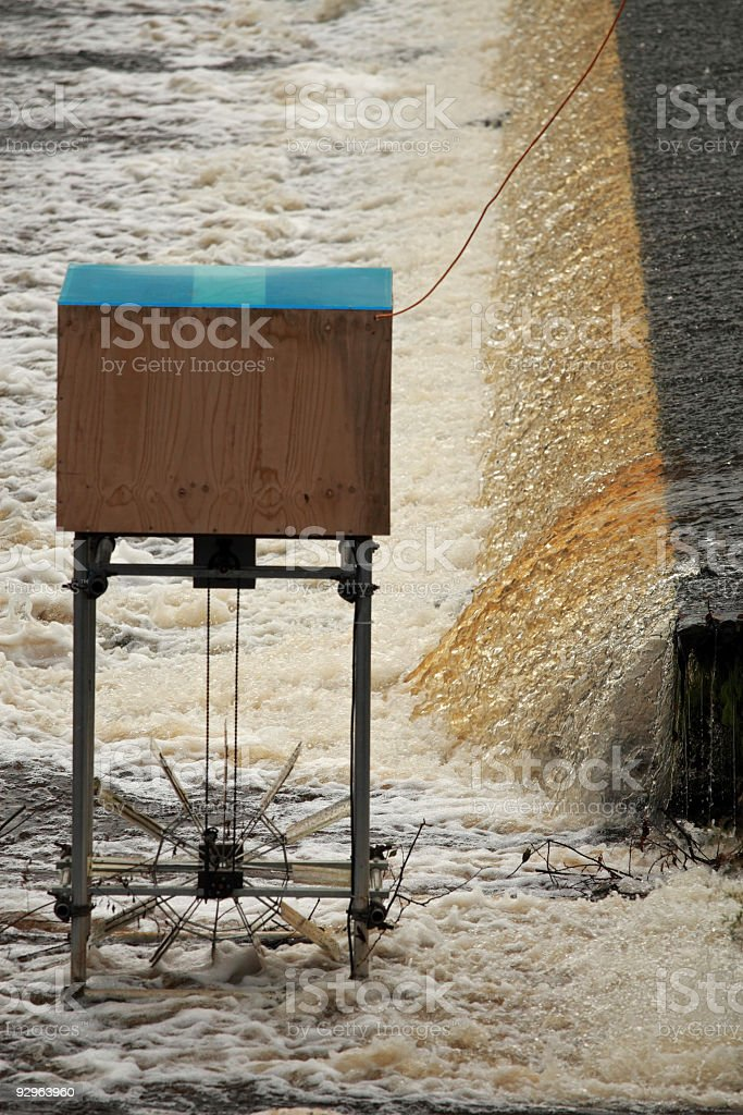 small hydro-electric generator and weir stock photo
