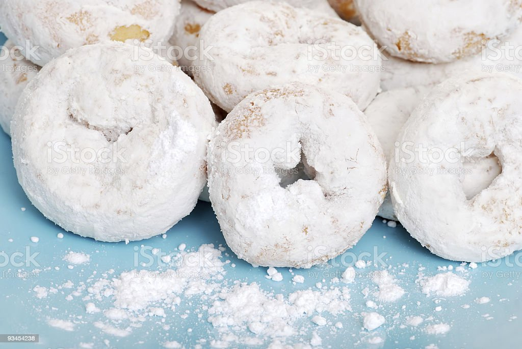 small icing sugar covered donuts stock photo