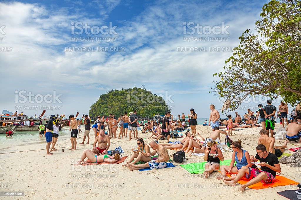 Small island crowded with tourists. stock photo
