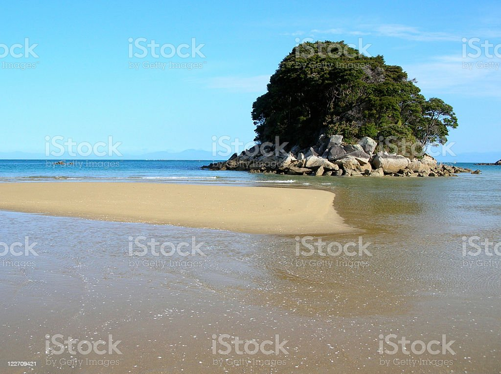 Small island in the ocean royalty-free stock photo