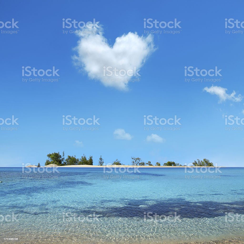 small island over heart shaped cloud stock photo