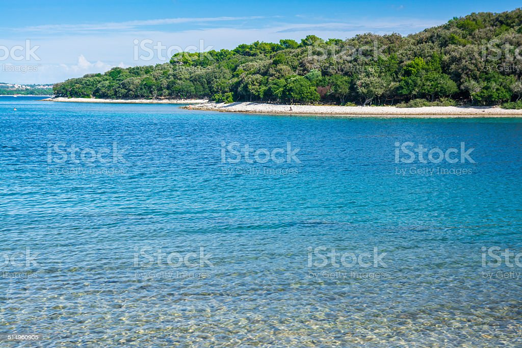 Small island with deep blue sea stock photo