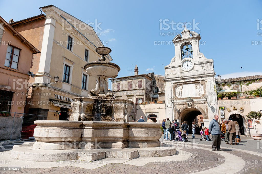 Small Italian village square with people gathering stock photo