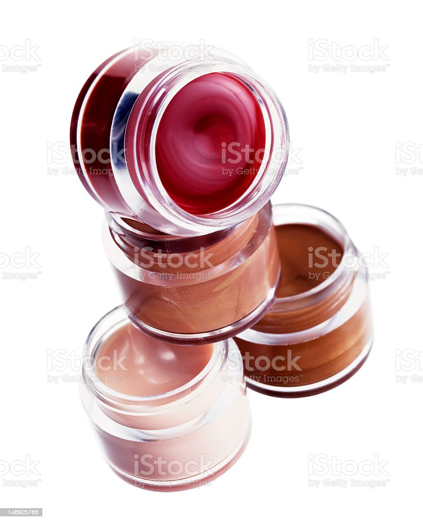 4 small jars of different colored lipglosses royalty-free stock photo