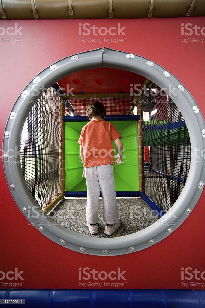 Small kid inside playground maze royalty-free stock photo