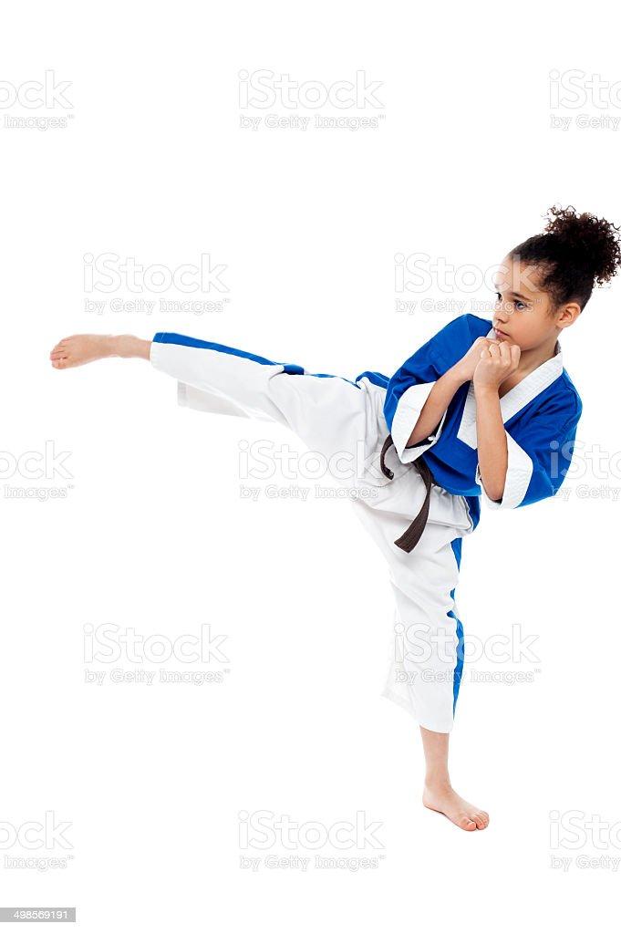 Small kid practicing karate kick royalty-free stock photo