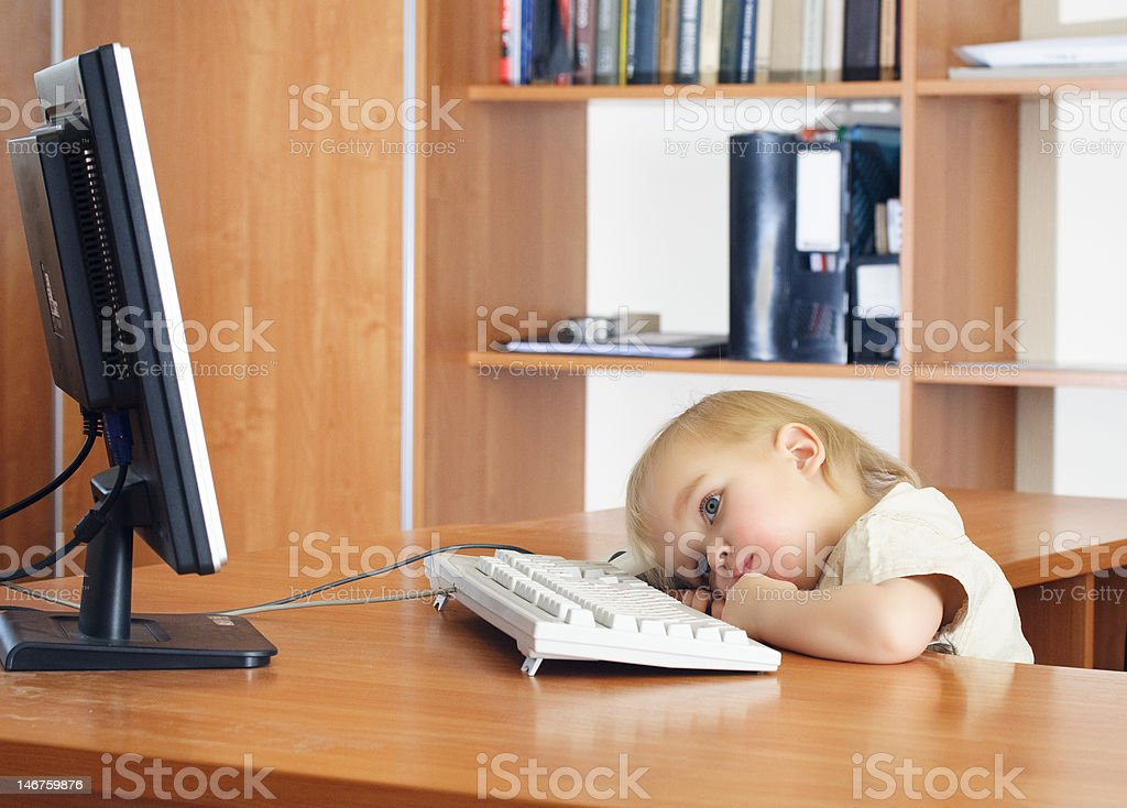 Small kid with computer royalty-free stock photo